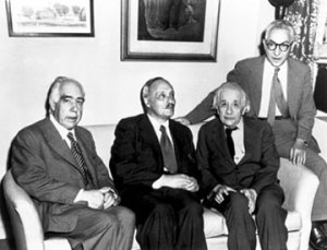 Eistein and Bohr and other scientist sit together for photograph.